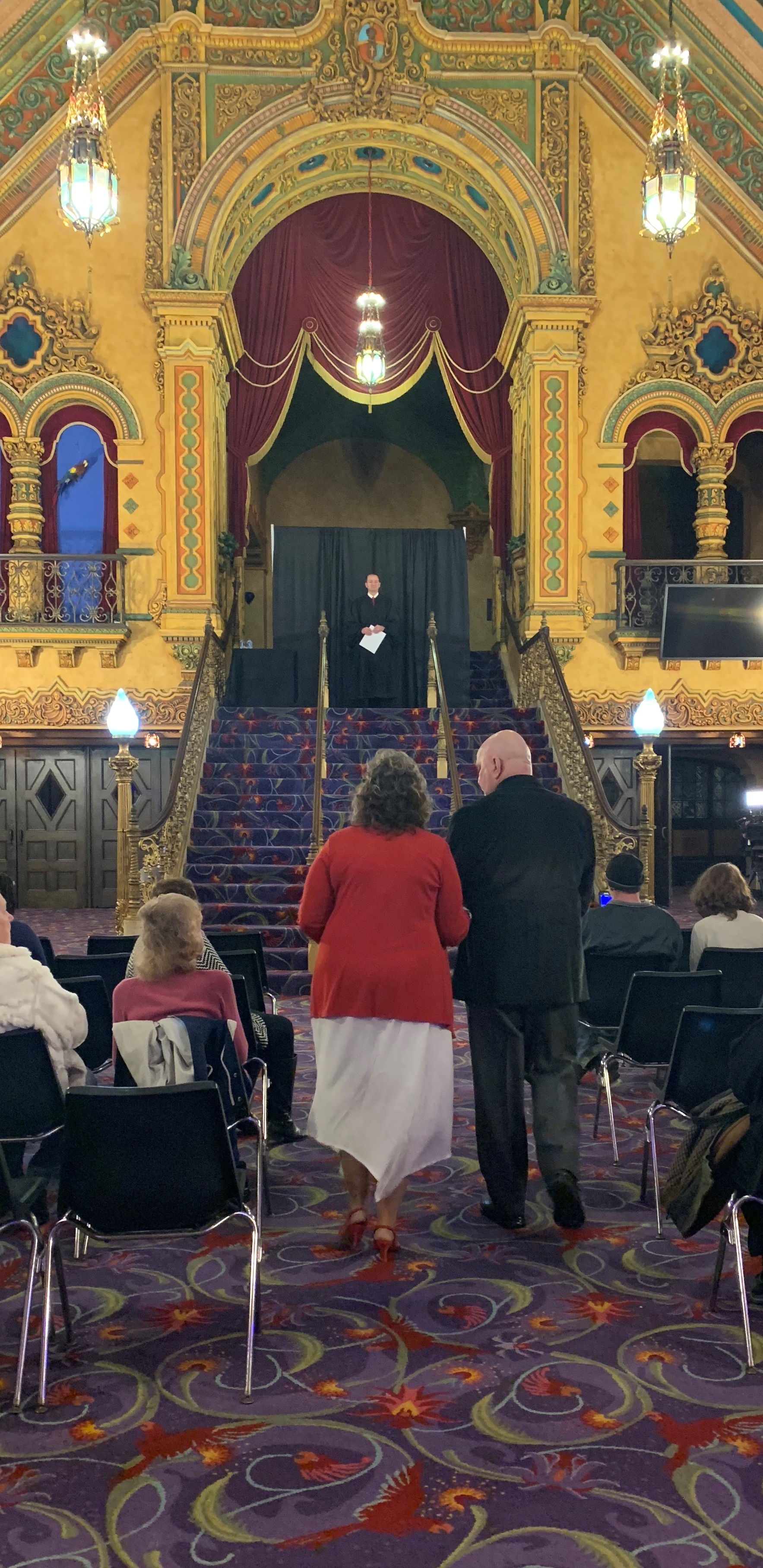 A couple walks down the aisle at the Akron Civic Theatre on Valentine's Day 2019